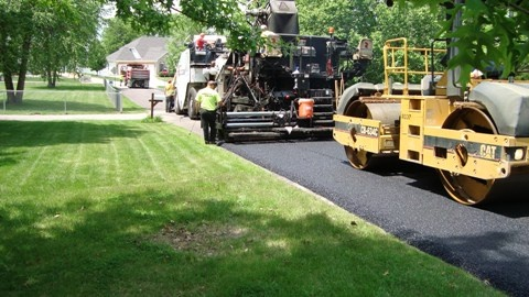 Rolling the material falls right in behind placement by the paver